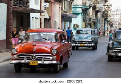 HAVANA - DECEMBER 13: Classic Chevrolet cars in a street on December 13, 2012 in Havana. These old and classic cars are an iconic sight of the island