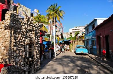 HAVANA - DECEMBER 23: Graffiti in Alley Hamel on December 23,2012 in Havana, Cuba. Callejon de Hamel is an alley with evocative murals, the inspiration by local artist Salvador Gonzalez.