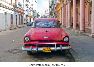 HAVANA - DECEMBER 29 2006: Bright red classic American Plymoth car parked at Old town Havana, Cuba on December 29 2006.