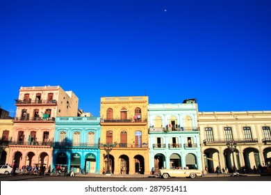 HAVANA - FEB 5: Classic Cars in  Old Havana main street, on February 5th, 2015 Havana, Cuba.Old cars and the UNESCO protected part of Old City are attracting millions of tourists every year