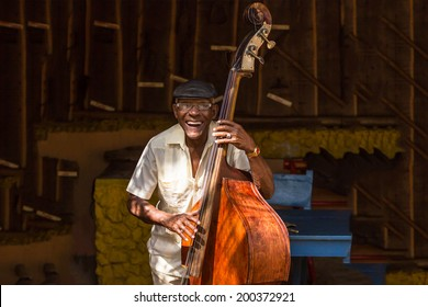 HAVANA - FEBRUARY 2: Old man plays the contrabass February 2, 2013 in Havana, Cuba. Cuban music is an attraction for the over 2 million tourists who go to Cuba each year.