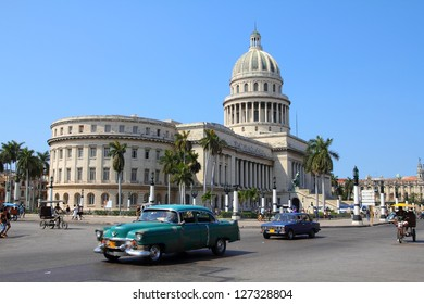 HAVANA - FEBRUARY 26: Cubans drive Classic American cars on February 26, 2011 in Havana, Cuba. Recent change in law allows the Cubans to trade cars after it was forbidden for many years.
