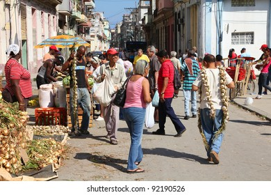 HAVANA - FEBRUARY 26: Cubans shop in the street on February 26, 2011 in Havana, Cuba. Farmer's markets are very popular in Cuba even in large cities due to general shortage of goods.