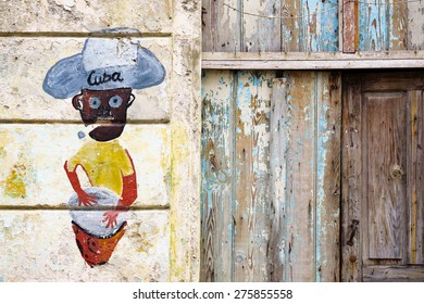HAVANA, JAN 26: Graffiti of Cuban man with cigar on January 26, 2015 in Havana, Cuba. When visiting Cuba, it was hard to tell the difference between graffiti and murals commissioned by the government