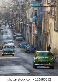 HAVANA - JANUARY 15: Classic cars riding in a street on January 15, 2013 in Havana. These old and classic cars are an iconic sight of the island
