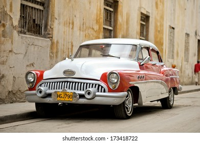 HAVANA - JANUARY 3: A vintage car parked in Havana, Cuba on January 3, 2012.