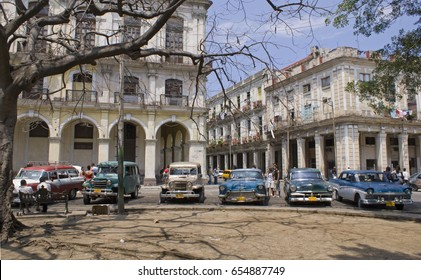 HAVANA - MARCH 30 2008: Classic American cars parked at Old town Havana, Cuba on March 30 2008.