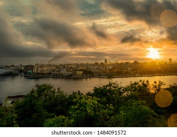 Havana old town city at river with dark clouds and lens flare at sunset