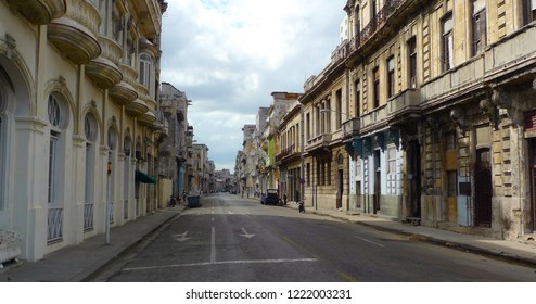 Havana street in perspective. Wide and deserted street of the Cuban capital with its unique architecture, majestic and old houses. Havana, Cuba.