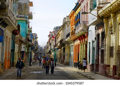 Havana Streets /Cuba - January 20,2018: The streets of Havana is full of interesting poeple and old american cars for the photographers at Cuba