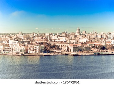 Havana. View of the old city through a bay from Morro's fortress,with a retro effect