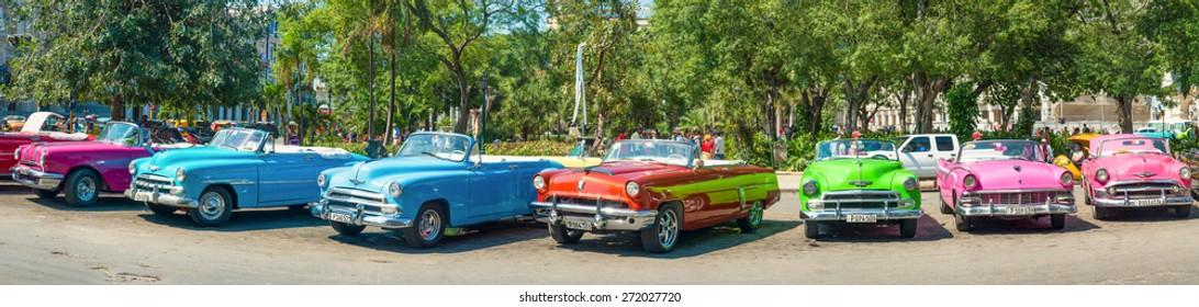 HAVANA,APRIL 3,2015 : Group of colorful vintage cars parked in Old Havana