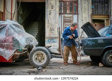 Havana,Cuba 02.02.2019 Street of Habana Cuba, Man are repairing the car