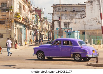 HAVANA,CUBA - 03 06 2013: authentic old street  in the city of Havana in the old district of Serrra. A vintage car on the road