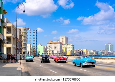 HAVANA,CUBA - AUGUST 12,2018 : Classic cars on the famous Malecon seaside avenue in Havana