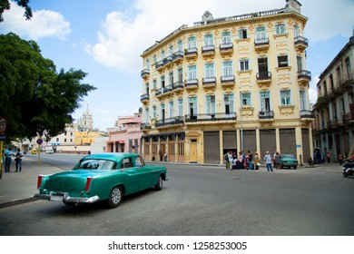 HAVANA-CUBA- DEC 4, 2018:  A classic American green vintage car in old Havana in Cuba.  Car owners can truly take pride in having survived an era of no spare car parts and protecting their beauties.