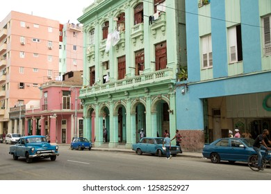 HAVANA-CUBA- DEC 5, 2018: Blue cars on the street in Centro Habana, one of the 15 municipalities or boroughs in the city of Havana, Cuba.