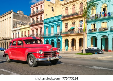 HAVANA,CUBA - DECEMBER 13,2017 : Urban scene with colorful buildings and old car in Havana