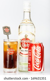 HAVANA,CUBA - DECEMBER 25, 2013:Havana Club rum bottle and coke can next to a Cuba Libre coktail.Established in Cuba in 1878, Havana Club is the world's No.3 rum brand and a symbol of cuban culture