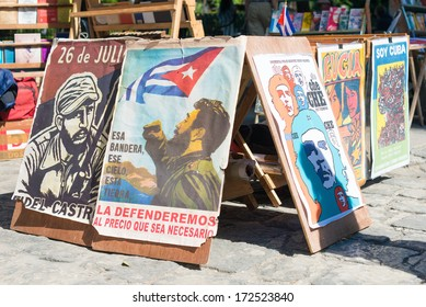 HAVANA,CUBA - JANUARY 20, 2014: Posters with revolutionary slogans for sale at a street market