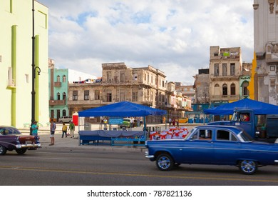 Havana,Cuba - January 21,2017: Havana Malecon. The Malecon (officially Avenida de Maceo) is a broad esplanade, roadway and seawall which stretches for 8 km (5 miles) along the coast in Havana