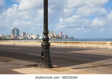 Havana,Cuba - January 22,2017: Havana Malecon. The Malecon (officially Avenida de Maceo) is a broad esplanade, roadway and seawall which stretches for 8 km (5 miles) along the coast in Havana