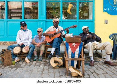 HAVANA,CUBA - JANUARY 5, 2015 : Senior cuban men playing traditional music in the streets of Old Havana