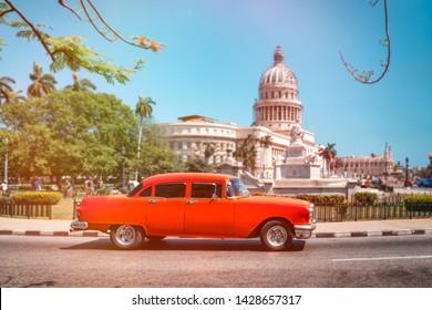 HAVANA,CUBA - JUNE 18,2019 : Classic american car next to the Capitol building in Old Havana