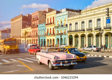 HAVANA,CUBA - MARCH 13,2018 : Street scene with classic old cars and traditional colorful buildings in downtown Havana