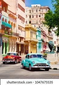 HAVANA,CUBA - MARCH 16,2018 : Classic cars at sunset in downtown Havana