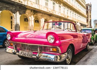 HAVANA,CUBA - MARCH 18,2019: Colourful old American taxi cars parked in Havana, La Habana, Cuba, West Indies, Caribbean, Central America
