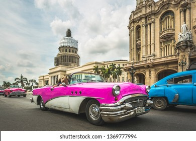 HAVANA,CUBA - MARCH 18,2019: Vintage convertible American car driving along the  El Capitolio, La Habana, Havana, Cuba, West Indies, Caribbean, Central America