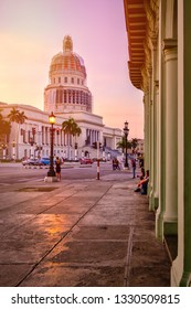 HAVANA,CUBA - MARCH 3,2019 : Urban scene with the Capitol building in downtown Havana at sunset