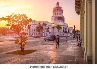 HAVANA,CUBA - MARCH 3,2019 : Urban scene in Havana at sunset with the Capitol building