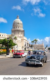 HAVANA,CUBA - MAY 3,2018 : Classic american cars in downtown Havana with the iconic Capitol building