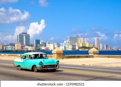 HAVANA,CUBA - SEPTEMBER 29,2018 : Classic car at the famous seaside Malecon avenue in Havana