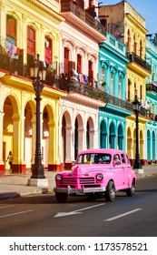 HAVANA,CUBA - SEPTEMBER 5,2018 : Street scene with classic car and colorful buildings at sunset in Old Havana