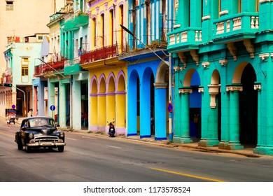 HAVANA,CUBA - SEPTEMBER 5,2018 : Street scene with old classic car and colorful buildings in Havana
