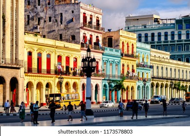 HAVANA,CUBA - SEPTEMBER 5,2018 : Street scene with colorful buildings at sunset in Old Havana