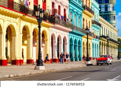 HAVANA,CUBA - SEPTEMBER 5,2018 : Street scene with classic car and colorful buildings in Old Havana
