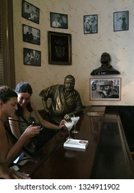 Havana/CUBA-2015 May 01: El Floridita Bar.Bronze statue of Hemingway and tourists.
