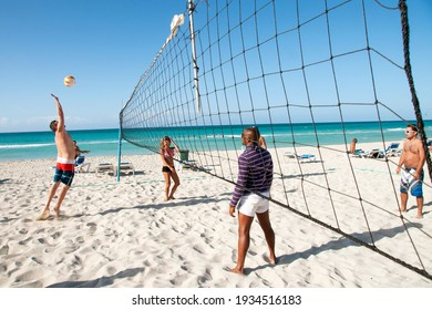 Havana-Cuba-25.09.2020: Beach holidays. People play beach volleyball. Varadero Beach Resort.