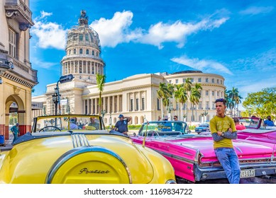 Havana,Cuba-July 8, 2018: Old cars in the Capitol building. Their self employed driver give tour of the city to visitors. The area is a major tourist attraction in the Cuban capital city