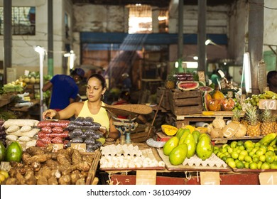 HAVANA,CUBA-OCTOBER 13:Woman selling fruits in market in Havana October 13,2015 in Havana. With 2.4 mil. inhabitants in the city and 3.7 in its urban area, Havana is the largest city in the Caribbean