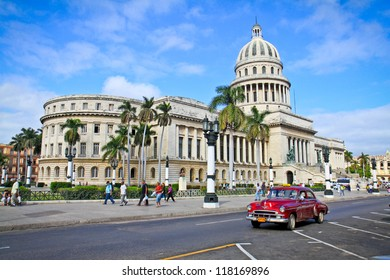 HAVANA-FEB 3:Classic cars in front of the Capitol Feb 3,2010 in Havana.Cubans keep thousands of them running even when parts have not been made for decades and they've become an icon of the country