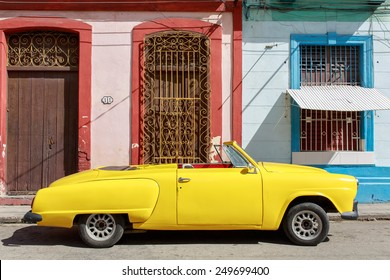 HAVANA-FEBRUARY 01:Classic American yellow car February 01,2015 in Havana.Before a new law issued on October 2011,cubans could only trade old cars that were on the road before the revolution of 1959