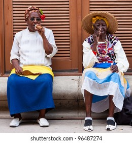 HAVANA-FEBRUARY 26:Women in typical clothing February 26,2012 in Havana.With the growth of foreign tourism people like these,working for tips,make their living posing as traditional cuban characters