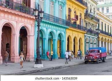 HAVANA-JUNE 21:Typical street scene with people and colorful buildings on June 21, 2013 in Havana.With over 2 million inhabitants Havana is the capital of Cuba and the largest city in the Caribbean