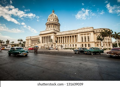 HAVANA-JUNE 7: Old car rides in front of the Capitol on June 7, 2011 in Havana. Before a new law issued on October 2011, cubans could only trade cars that were on the road before 1959.