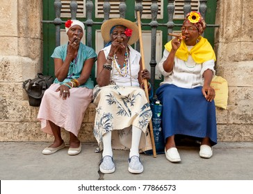 HAVANA-MAY 19:Old ladies with cigars May 19,2011 in Havana.Iconic characters like these are an attraction for the more than 2 million tourists who go to Cuba each year to enjoy its distinct culture